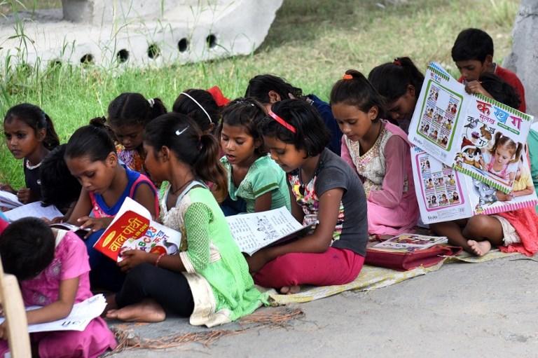 Concrete Slab - Slum child - poor - poverty - Student - Education - Delhi